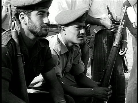 stockvideo's en b-roll-footage met israeli soldiers sitting outdoors listening / israel / documentary - 1948