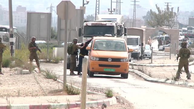 israeli soldiers stand guard at the hawara checkpoint south of the west bank city of nablus after according to the army an israeli reserve soldier... - west bank stock videos & royalty-free footage