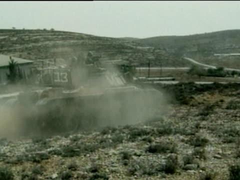 israeli tanks drive over dusty terrain oct 00 - gaza strip stock videos & royalty-free footage