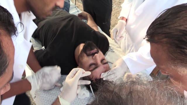 israeli troops on friday injured an anadolu agency photojournalist when he was covering peaceful rallies in gaza strip ali jadallah who was hit by a... - photojournalist stock videos & royalty-free footage