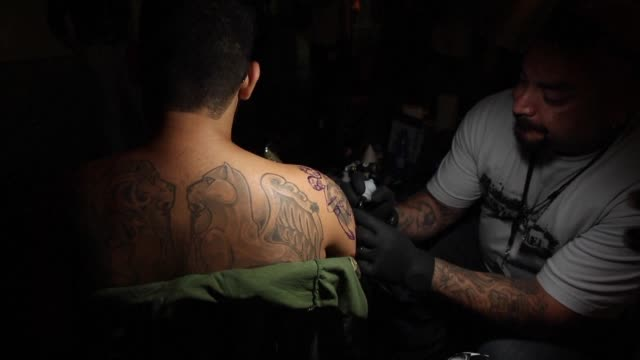 vídeos de stock, filmes e b-roll de israeli war veterans relatives and victims of attacks on civilians received free tattoos in jerusalem on thursday in an initiative to use art to heal... - physical injury