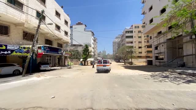 israeli warplanes on thursday, may 13, pounded several spots on the gaza strip, including a residential building, two banks, homes and a government... - ガザ地区点の映像素材/bロール