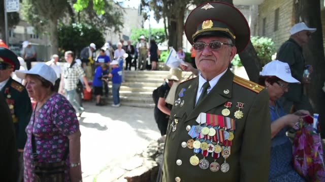 Israeli World War II veterans from the former Soviet Union and their families marched to celebrate the 72nd anniversary of the allied victory over...
