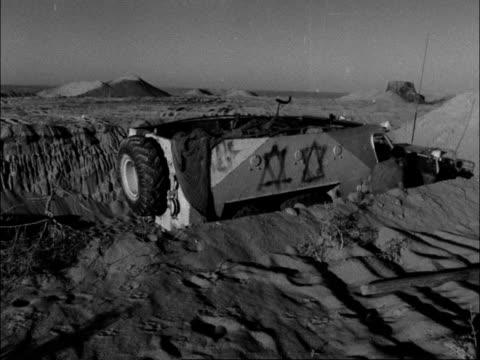 """vidéos et rushes de israelis build up forces; egypt/israeli held: desert road to quantara: sissons: """"this is the very long and hot and dusty road which bores down the... - canal de suez"""