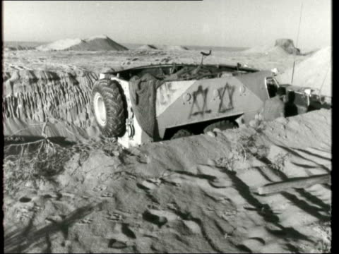"""israelis build up forces; egypt/israeli held: desert road to quantara: sissons: """"this is the very long and hot and dusty road which bores down the... - suezkanalen bildbanksvideor och videomaterial från bakom kulisserna"""