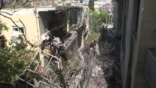 stockvideo's en b-roll-footage met israelis check the damage at their house the day after it was hit in a strike in givatayim, a suburb of tel aviv, which was targeted during the night... - israël