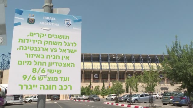 Israelis in Jerusalem react to the news that a friendly football match between Argentina and Israel that was slated to take place on Saturday was...