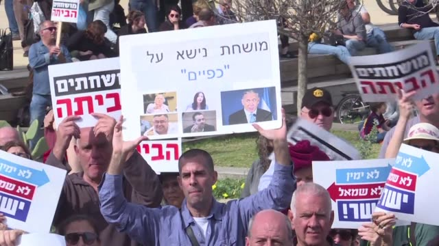 Israelis protested against corruption Friday in Tel Aviv holding up signs saying Crime Minister after police recommended the indictment of Prime...