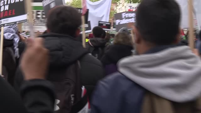 israel-palestine conflict: palestine solidary demonstration in london; england: london: ext various of protesters marching along street, wearing foa... - clock tower stock videos & royalty-free footage