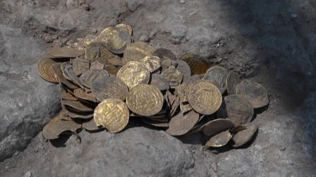 israel's antiquities authority unveils a trove of 425 pure gold coins said to be some 1,100 years old, dating to the abbasid caliphate, discovered in... - archaeology stock videos & royalty-free footage