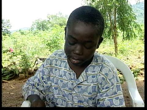 Issa Kamara flies to Britain for treatment ITN SIERRA LEONE Freetown EXT MS LMS 10 year old Issa Kamara swimming along in pool MS Issa sitting at...