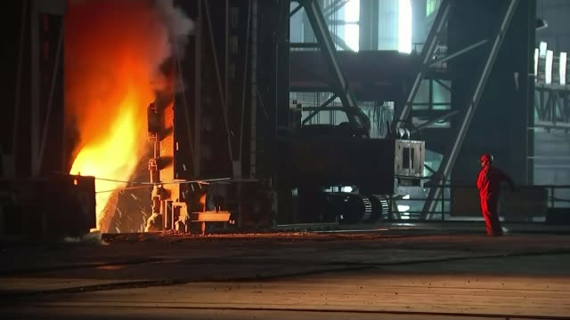EU issues retaliation threat over US tariffs plan T16101525 / Shanghai Shagan Steelworks Wide shot steelworker working by furnace Flame and sparks...