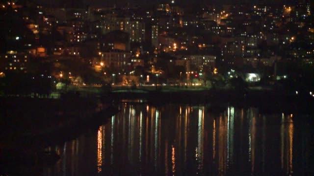 / istanbul at night shoreline buildings twinkling lights bosphorus - organised group stock videos & royalty-free footage