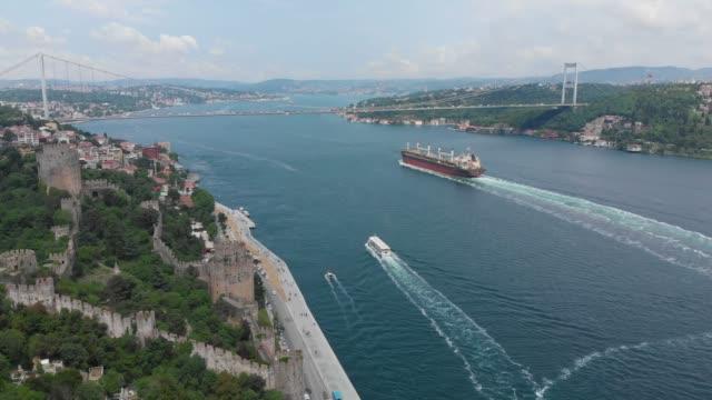 istanbul, bosphorus and fatih sultan mehmet bridge - stretto video stock e b–roll
