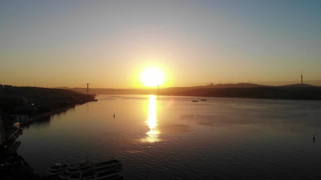 istanbul bosphorus bridge sunrise - byakkaya stock videos and b-roll footage
