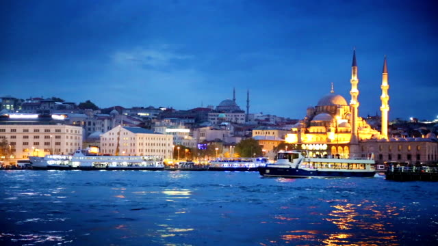 istanbul bosphorus river with boat crossing at night - yeni cami mosque stock videos and b-roll footage