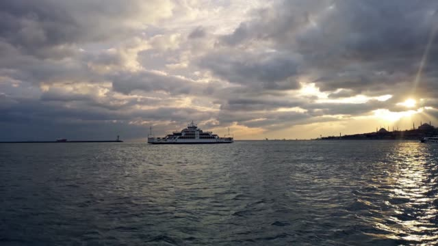 istanbul ferry on marmara sea with dramatic sky on sunset - marmara stock videos and b-roll footage