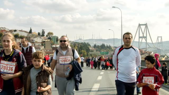 istanbul marathon on bosporus bridge - turkish culture stock videos and b-roll footage