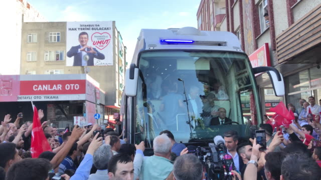 istanbul mayoral candidate binali yildirim of the ruling justice and development party waves to supporters from his bus during a campaign street stop... - nutzfahrzeug stock-videos und b-roll-filmmaterial