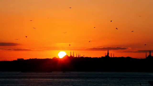 istanbul sunset behind the silhouette of blue mosque - bosphorus stock videos & royalty-free footage