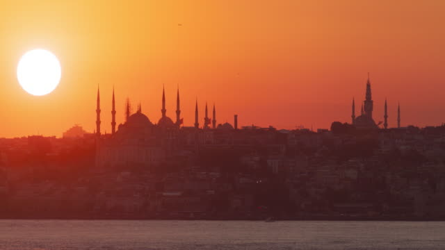 istanbul sunset behind the silhouette of blue mosque - hagia sophia istanbul stock videos & royalty-free footage