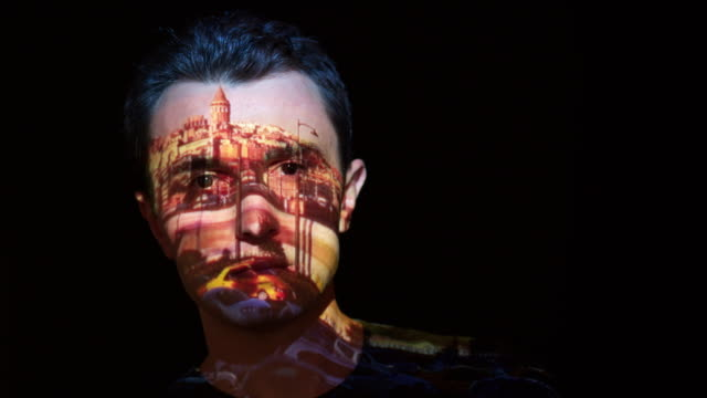 Istanbul timelapse projection on man's face