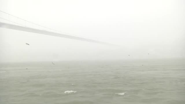 istanbul's bosphorus has been closed to all naval traffic early saturday due to a fog caused by heavy snowfall the passage from the bosphorus from... - sea passage stock videos and b-roll footage