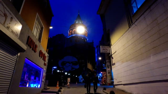 Istanbul's famous Galata tower is seen with its lights on ahead of going dark for the Earth Hour environmental campaign on March 25 2017 in Istanbul...