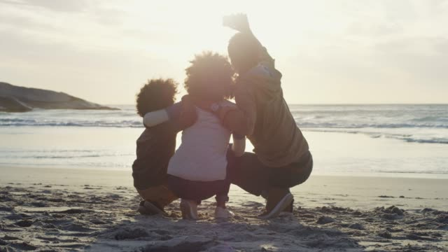 it all starts and ends with family - strand south africa stock videos & royalty-free footage