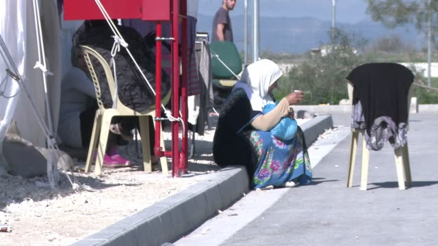 it costs thousands of euros for a false passport and place on a boat to turkey but syrian refugees stranded in cyprus are ready to try anything - financial item stock videos & royalty-free footage