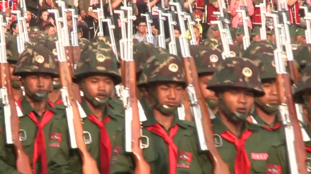 it has a standing army of 25000 manufactures its own guns and conscripts at least one member of each household the china backed rebels of the united... - military parade stock videos & royalty-free footage