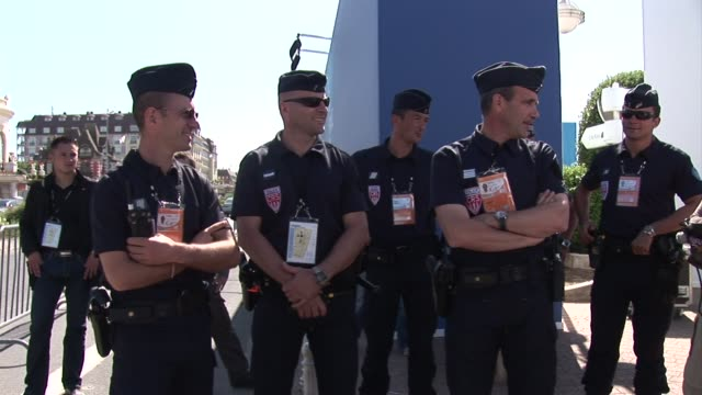 it has become as familiar a sight at g8 summits as a group photo of seven men and angela merkel in suits -- the french resort of deauville is locked... - security blanket stock videos & royalty-free footage