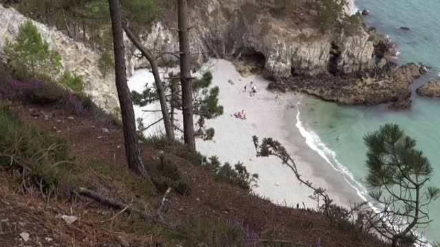 it is a small cove of white pebbles surrounded by the translucent waters of the crozon peninsula - translucent stock videos & royalty-free footage