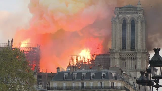 it is almost eight o'clock in the evening when the spectacular gothic spire of notre dame collapses before the eyes of horrified onlookers - spire stock videos & royalty-free footage