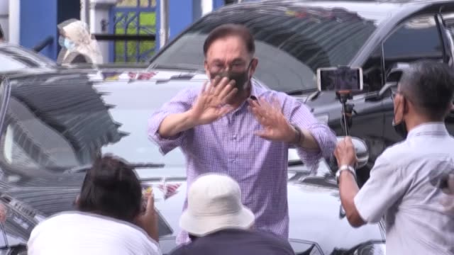 """""""it is clearly malicious, it is clearly a political harassment,"""" malaysia's opposition leader anwar ibrahim tells reporters after spending around two... - push in stock videos & royalty-free footage"""