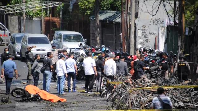 it is one year on since a family of six including two girls aged nine and 12 blew themselves up at the santa maria catholic church and two other... - surabaya stock videos & royalty-free footage