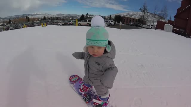 it looks like one-year-old sloan henderson may be starting as she means to go on in this video. her parents katie and zachary took her out for her... - looking stock videos & royalty-free footage