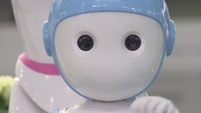it speaks two languages gives math lessons tells jokes and interacts with children through the tablet screen in its chest china's latest robot is the... - science and technology stock videos & royalty-free footage