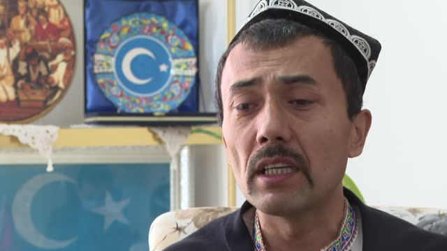 it was a sunny summer day when alimcan turdiniyaz decided it was time to leave his homeland, where has lived all of his life, after he found out that... - china east asia stock-videos und b-roll-filmmaterial