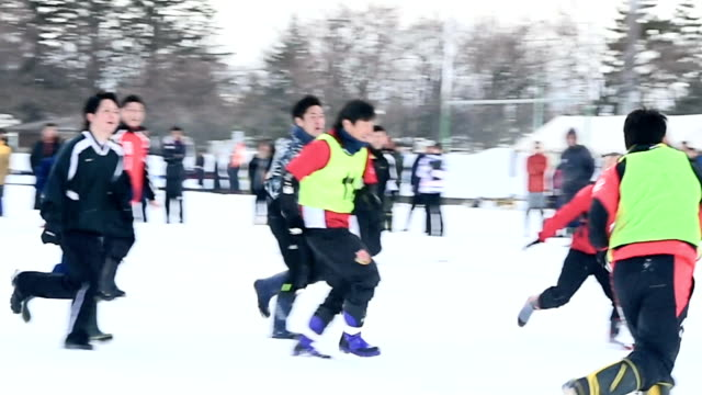 it was gloves off for residents of hirosaki aomori prefecture when they put their snow shovels to tackle some snow rugby instead on february 6 and 7... - winter sports event stock videos and b-roll footage