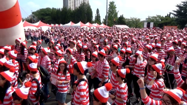 it was no work spotting where wally was in hirakata, osaka prefecture, on october 2 japan. about 4,000 people dressed up as the protagonist from the... - treasure hunt stock videos & royalty-free footage