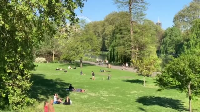 it was seen that the sunbathers and walkers in trafalgar square and saint james park were warned by the police on april 25, 2020. the number of... - public park stock videos & royalty-free footage