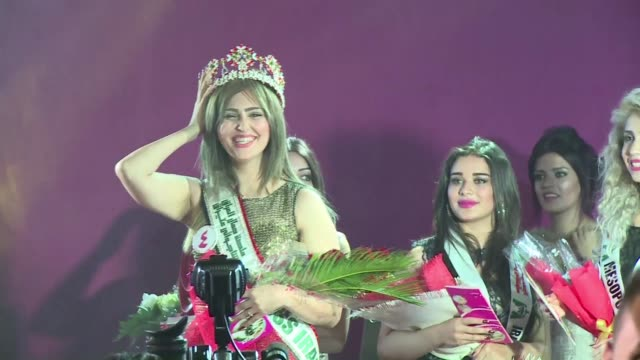 it was smoky alcohol free and there was no swimsuit contest but saturdays party produced the first miss iraq in four decades and left all feeling a... - beauty queen stock videos and b-roll footage