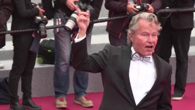 Italian actor and director Roberto Benigni French director Valerie Donzelli and US actor John Savage walk the Cannes red carpet