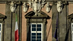 Italian and European flag on a balcony moved by the wind