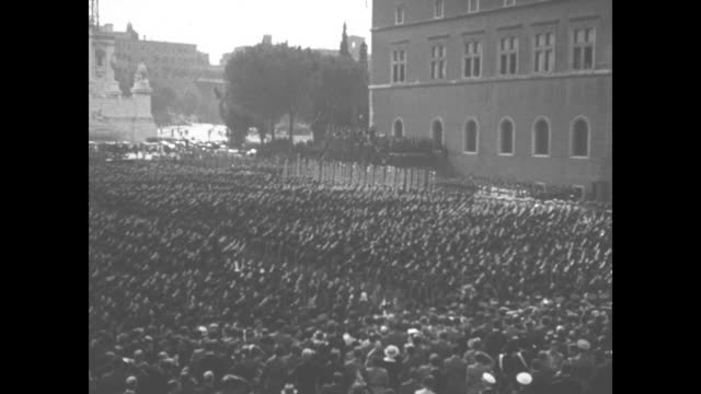 ls italian blackshirts march toward and past camera roman colosseum behind them / vs of columns of fascist troops in front of the victor emmanuel... - piazza venezia stock videos and b-roll footage