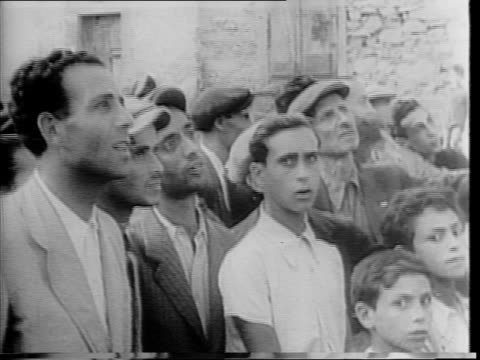 italian civilians lined up waiting for food / man in suit giving out food, rations / allied soldiers in room speaking to italian officials in suits /... - 1943 stock videos & royalty-free footage