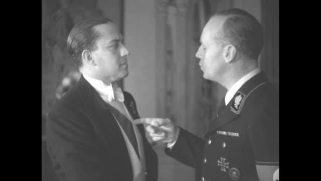 italian count galeazzo ciano speaks with german ambassador joachim von ribbentrop / elegantly dressed people walk past camera // file shot air... - hermann goering stock videos & royalty-free footage