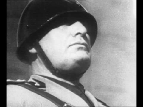italian dictator benito mussolini in helmet during world war ii / truck passes by in rome street with large group riding on sides, top / packed bus... - benito mussolini stock videos & royalty-free footage