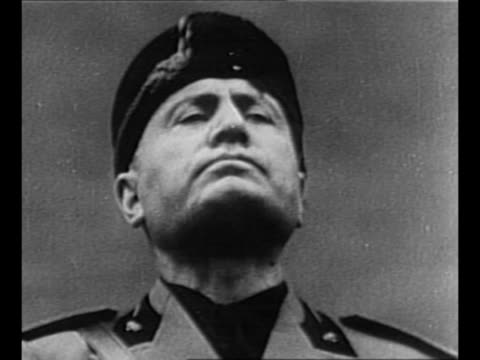 italian dictator benito mussolini speaks defiantly, gestures emphatically / italian soldiers march in streets of rome / mussolini / soldiers massed... - benito mussolini stock videos & royalty-free footage